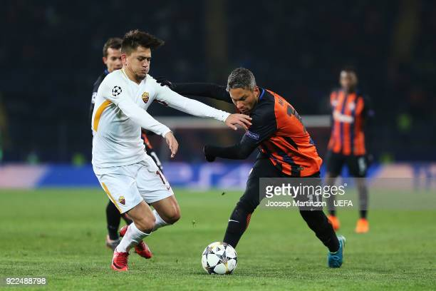 Marlos of Shakhtar Donetsk gets away from Cengiz Under of AS Roma places the ball during the UEFA Champions League Round of 16 First Leg match...