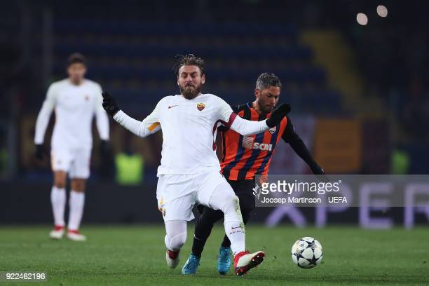 Marlos of Shakhtar Donetsk tackles Daniele De Rossi of AS Roma during the UEFA Champions League Round of 16 First Leg match between Shakhtar Donetsk...
