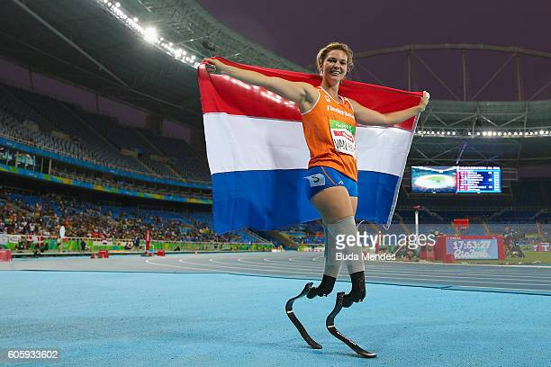 Marlou van Rhijn of Netherlands celebrates the gold medal in the Women's 200m T44 Final on day 8 of the Rio 2016 Paralympic Games at the Olympic...