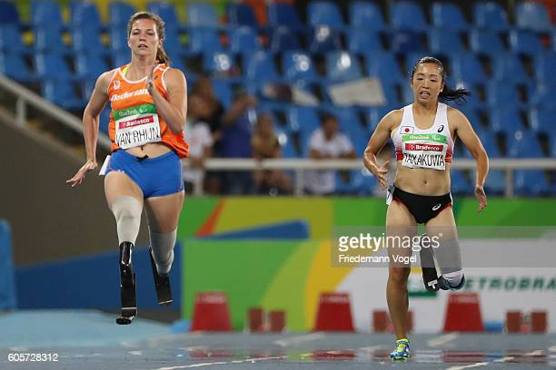 Marlou van Rhijn of the Netherlands and Saki Takakuwa of Japan compete in the Women's 200m T44 Heat on day 7 of the Rio 2016 Paralympic Games at the...