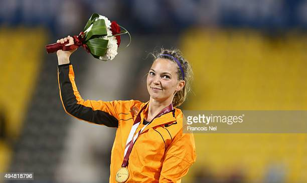 Marlou van Rhijn of the Netherlands celebrates her gold medal in the women's 100m T44 final during the Evening Session on Day Eight of the IPC...