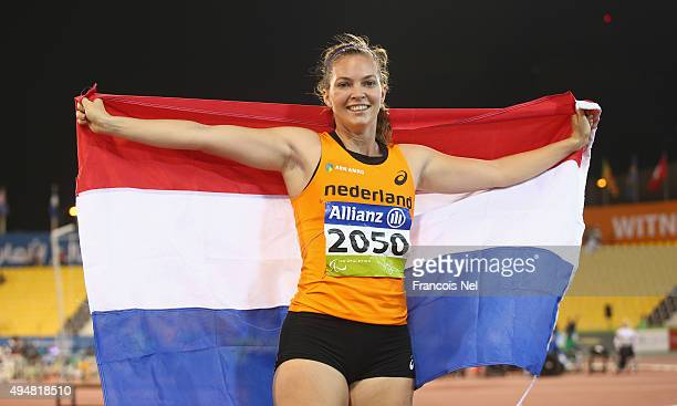 Marlou van Rhijn of the Netherlands celebrates winning the women's 100m T44 final during the Evening Session on Day Eight of the IPC Athletics World...