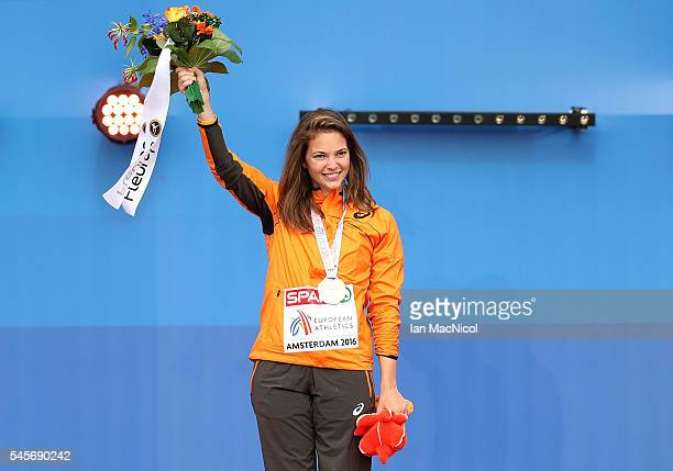 Marlou van Rhijn of The Netherlands celebrates with her medal after winning gold in the final of the womens T43/T44 200m on day four of The 23rd...