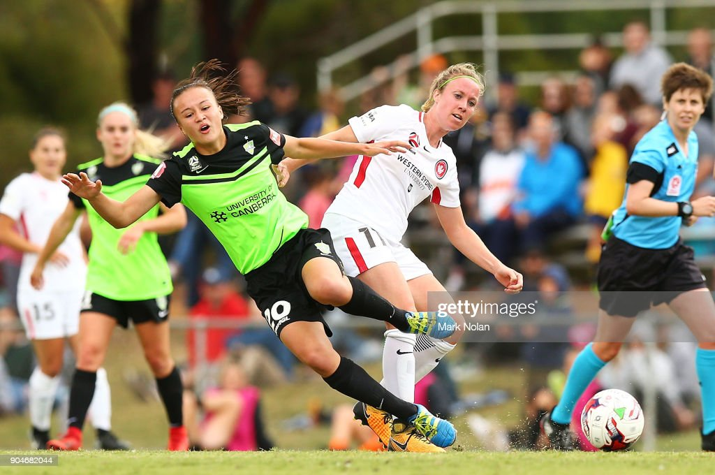 Marlous Pieete of the Wanderers tackles Amy Sayer of Canberra during the round 11 W-League match between Canberra United and the Western Sydney Wanderers at McKellar Park on January 14, 2018 in Canberra, Australia.