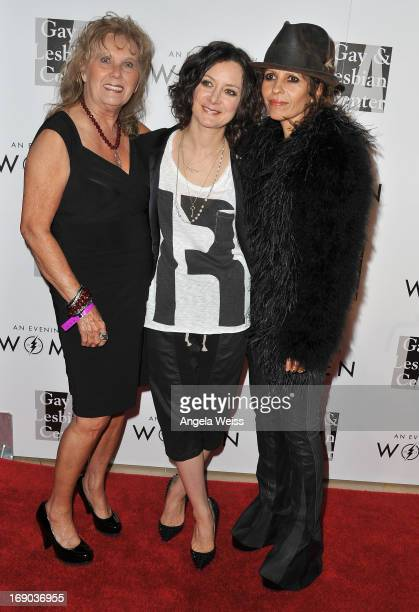 Marluce Perry actress Sara Gilbert and music producer Linda Perry arrive at the LA Gay Lesbian Center's 2013 'An Evening With Women' Gala at The...