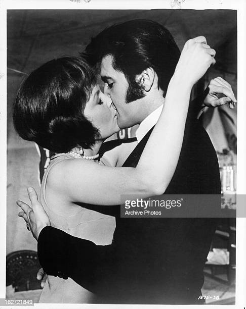 Marlyn Mason and Elvis Presley kissing in a scene from the film 'The Trouble With Girls' 1969