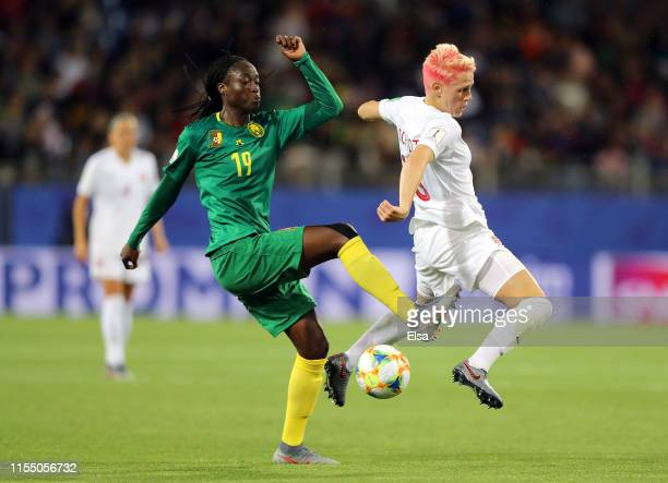 Marlyse Ngo Ndoumbouk of Cameroon battles for possession with Sophie Schmidt of Canada during the 2019 FIFA Women's World Cup France group E match...