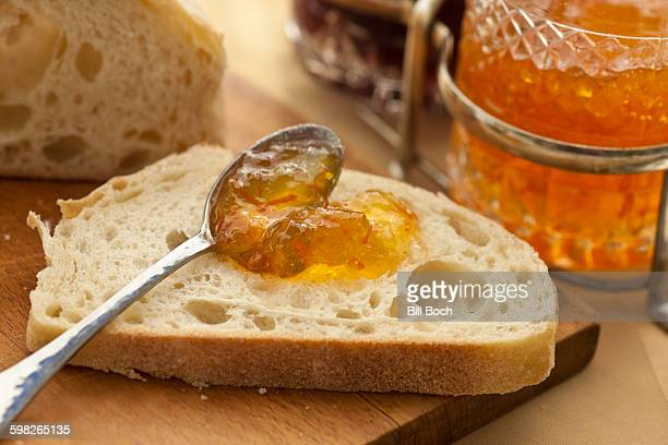 Marmalade spread on homemade bread
