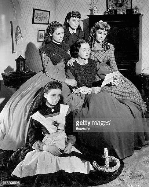 Marmee, played by Mary Astor, reads a letter from their father to her four girls, Jo, portrayed by June Allison, Margaret O'Brien as Beth, Elizabeth...