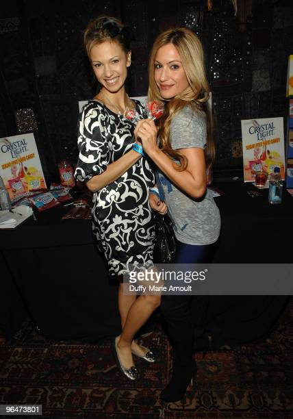 Marnette Patterson and TV Personality Rebecca Cardon pose with Sorbee sugar free candy at the Hollywood Helping Haiti Golden Globes Celebrity Charity...