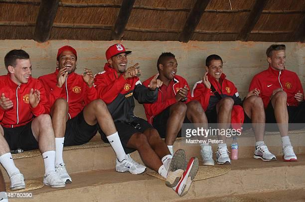 Marnick Vermijl Bebe Rio Ferdinand Anderson Javier 'Chicharito' Hernandez and Anders Lindegaard of Manchester United watch an African dancing display...