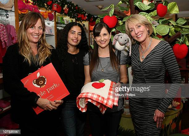 R Marnie Owen Karis Jagger actress Kellie Martin and Susan Tate attend the holiday celebration with Kellie Martin reading The Newest Children's Book...
