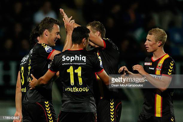 Marnix Kolder of Go Ahead in congratulated by team mates after he scores from the penalty spot during the Eredivisie match between RKC Waalwijk and...