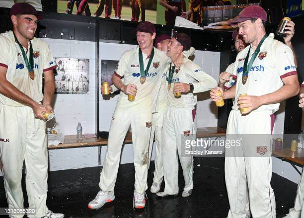 Marnus Labuschagne and Brendan Doggett of Queensland celebrate victory during day four of the Sheffield Shield Final match between Queensland and New...