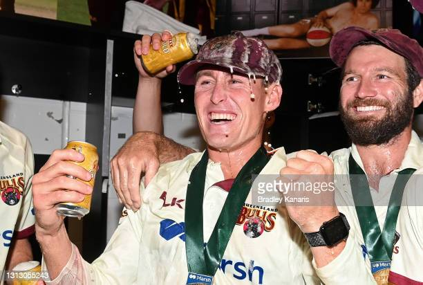 Marnus Labuschagne and Michael Neser of Queensland celebrate victory during day four of the Sheffield Shield Final match between Queensland and New...