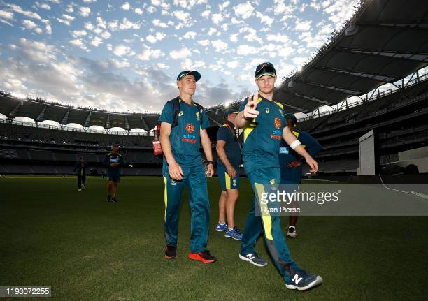 Marnus Labuschagne and Steve Smith of Australia arrive during an Australian Test team training session at Optus Stadium on December 10, 2019 in...