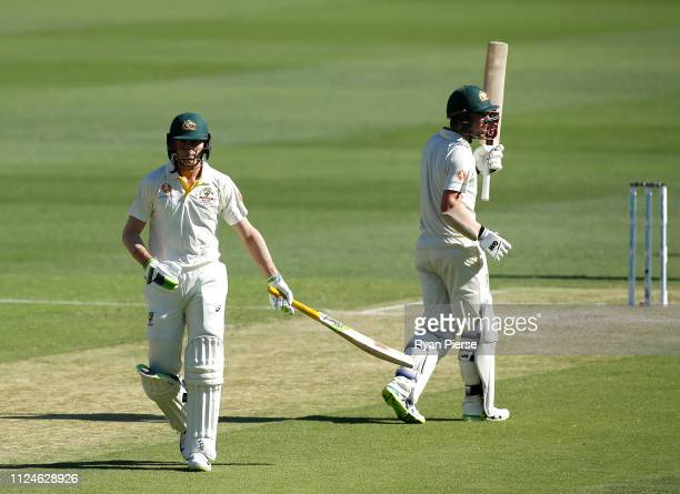 Marnus Labuschagne and Travis Head of Australia look on while batting during day two of the First Test match between Australia and Sri Lanka at The...