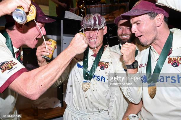 Marnus Labuschagne, Brendan Doggett, Michael Neser and Jack Wildermuth of Queensland celebrate victory during day four of the Sheffield Shield Final...