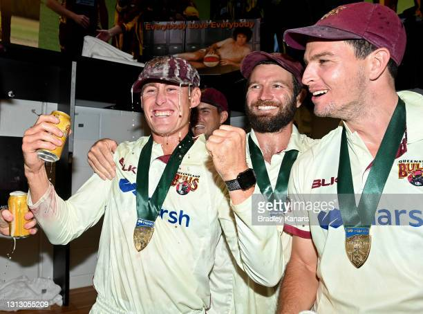 Marnus Labuschagne, Michael Neser and Jack Wildermuth of Queensland celebrate victory during day four of the Sheffield Shield Final match between...