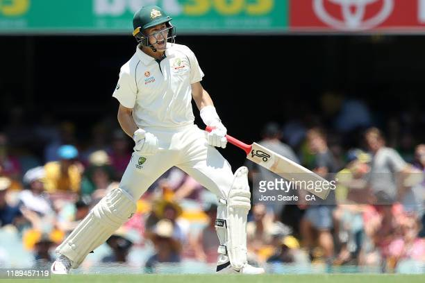 Marnus Labuschagne of Australia celebrates a century during day three of the 1st Domain Test between Australia and Pakistan at The Gabba on November...