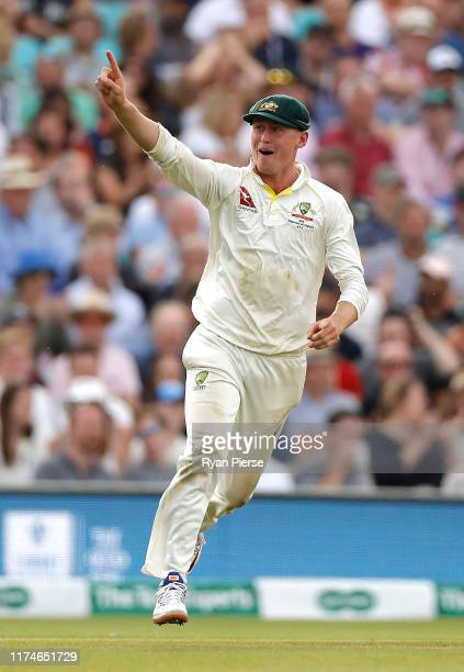Marnus Labuschagne of Australia celebrates after taking a catch to dismiss Jos Buttler of England off the bowling of Peter Siddle of Australia during...