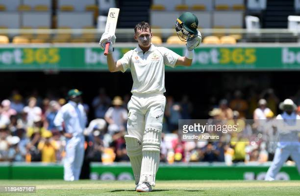 Marnus Labuschagne of Australia celebrates scoring a century during day three of the 1st Domain Test between Australia and Pakistan at The Gabba on...
