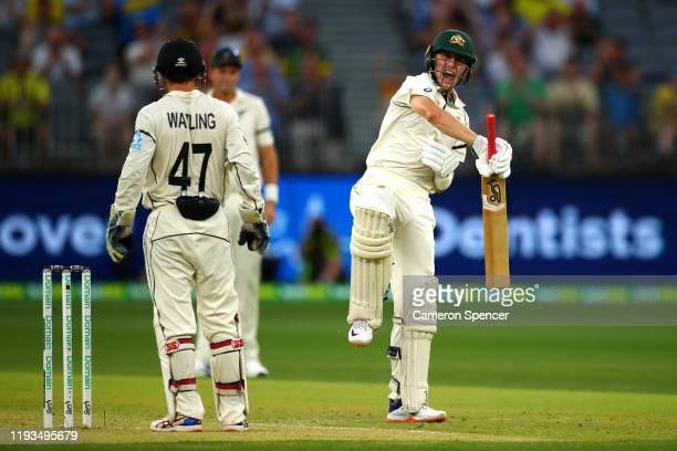 Marnus Labuschagne of Australia celebrates scoring a century during day one of the First Test match between Australia and New Zealand at Optus...