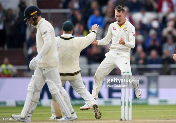 Marnus Labuschagne of Australia celebrates taking the wicket of Jack Leach of England with his teammates during Day Five of the 4th Specsavers Ashes...