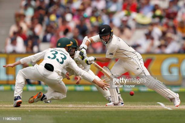 Marnus Labuschagne of Australia dives for 1 the ball as Tom Latham of New Zealand bats during day three of the Second Test match in the series...