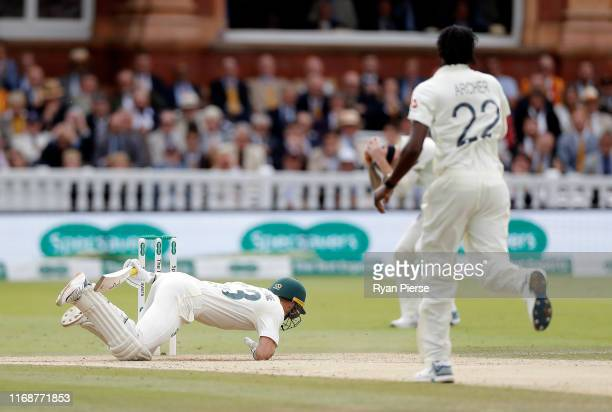 Marnus Labuschagne of Australia falls the the ground after being struck on the helmet by a delivery from Jofra Archer of England during day five of...