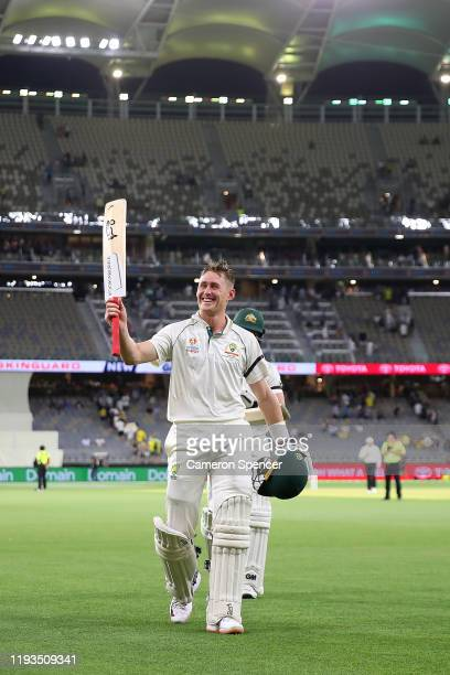 Marnus Labuschagne of Australia is applauded as he leaves the field not out on 110 runs during day one of the First Test match between Australia and...