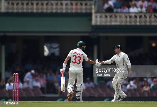 Marnus Labuschagne of Australia is congratulated by Tom Latham of New Zealand as he walks from the ground after being dismissed for 215 runs during...