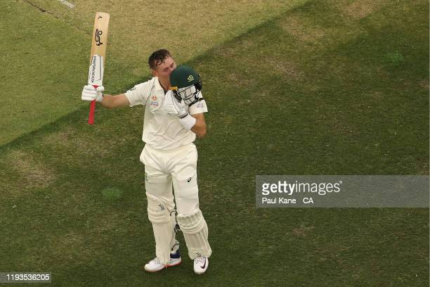 Marnus Labuschagne of Australia kisses the badge on his helmet after scoring his century during day one of the First Test match between Australia and...