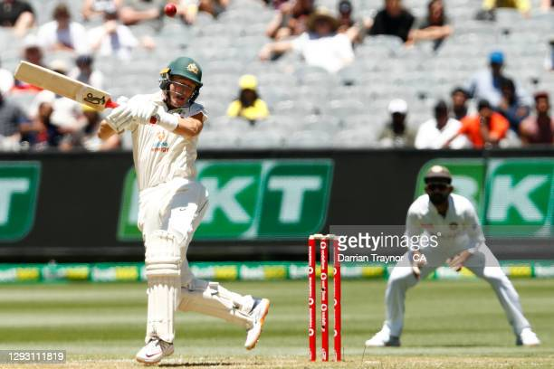 Marnus Labuschagne of Australia mis judges a short ball and is struck on the helmet during day one of the Second Test match between Australia and...
