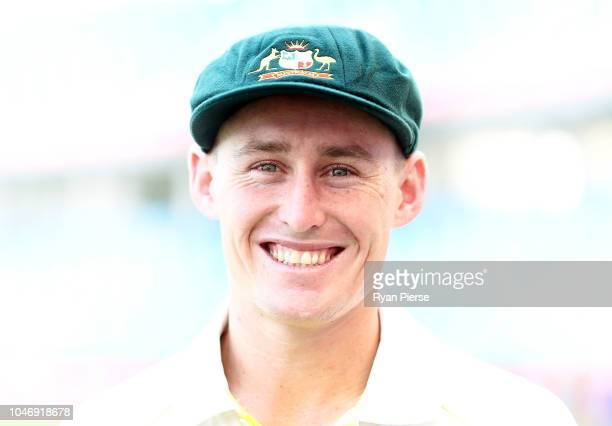 Marnus Labuschagne of Australia poses after receiving their Baggy Green Caps during day one of the First Test match in the series between Australia...