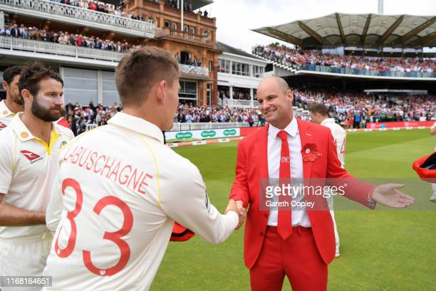 Marnus Labuschagne of Australia presents former England captain Andrew Strauss with his red cap ahead of day two of the 2nd Specsavers Ashes Test...