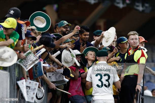 Marnus Labuschagne of Australia signs autographs after claiming victory during day four of the First Test match in the series between Australia and...