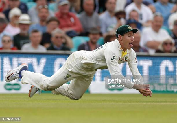 Marnus Labuschagne of Australia takes a catch to dismiss Jos Buttler of England off the bowling of Peter Siddle of Australia during day three of the...