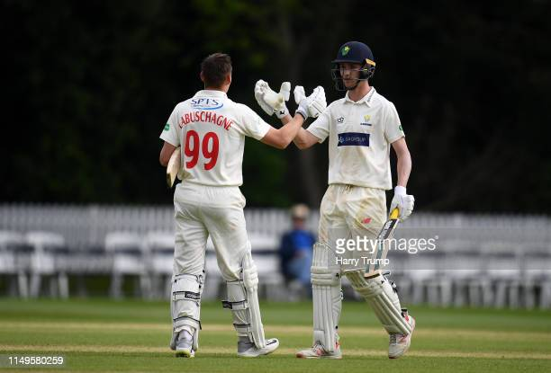 Marnus Labuschagne of Glamorgan celebrates after scoring a century with Nick Selman of Glamorgan during Day Three of the Specsavers County...
