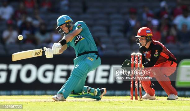 Marnus Labuschagne of Heat hits a six watched by Sam Harper of Renegades during the Big Bash League match between the Melbourne Renegades and the...