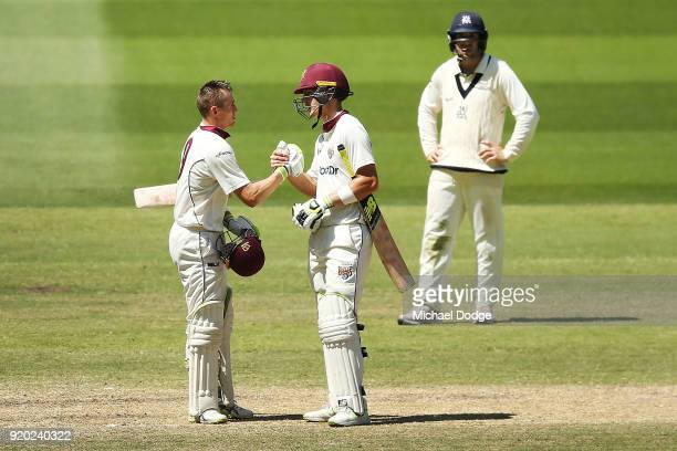 Marnus Labuschagne of Queensland celebrates making his century with Jack Wildermuth during day four of the Sheffield Shield match between Victoria...