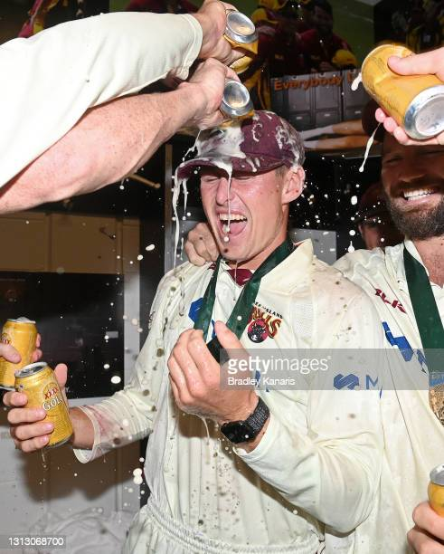 Marnus Labuschagne of Queensland celebrates victory with his team mates during day four of the Sheffield Shield Final match between Queensland and...