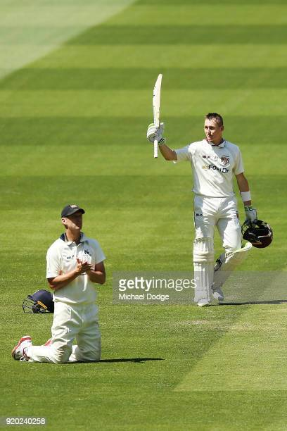 Marnus Labuschagne of Quennsland celebrates making his century next to Cameron White of Victoria during day four of the Sheffield Shield match...