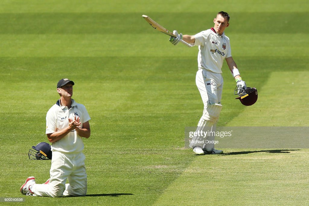 Marnus Labuschagne of Quennsland celebrates making his century next to Cameron White of Victoria during day four of the Sheffield Shield match between Victoria and Queensland at Melbourne Cricket Ground on February 19, 2018 in Melbourne, Australia.