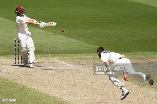Marnus Labuschagne of Quennsland hits Chris Tremain to Victoria during day four of the Sheffield Shield match between Victoria and Queensland at...