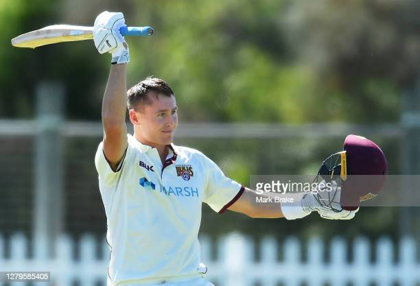 Marnus Labuschagne of the Queensland Bulls celebrates bringing up his century during day two of the Sheffield Shield match between Queensland and...
