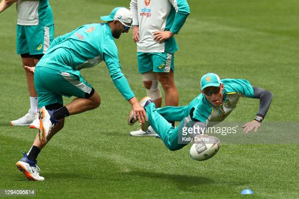 Marnus Labuschagne 'scores a try' while warming up during an Australian nets session at Melbourne Cricket Ground on January 02, 2021 in Melbourne,...