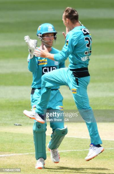 Marnus Laubuschagne of the Heat celebrates the wicket of Ashton Turner of the Scorchers with Jimmy Peirson of the Heat during the Big Bash League...