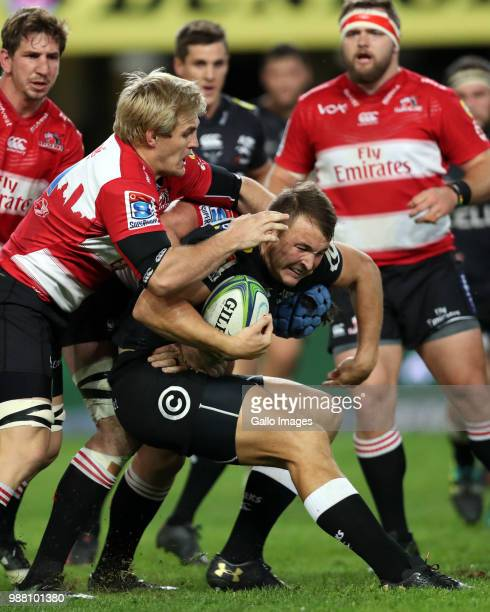 Marnus Schoeman of Emirates Lions tackling Andre Esterhuizen of the Cell C Sharks during the Super Rugby match between Cell C Sharks and Emirates...