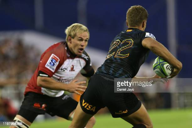 Marnus Schoeman of Lions chases Domingo Miotti of Jaguares during a match between Jaguares and Lions as part of Super Rugby 2020 at Jose Amalfitani...